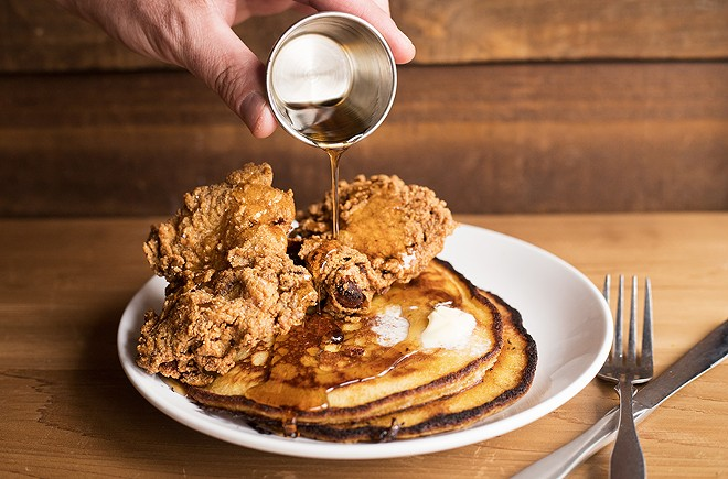 Chef Ellis subs Johnny cakes for waffles, pairing them with fried chicken to delicious effect. - MABEL SUEN