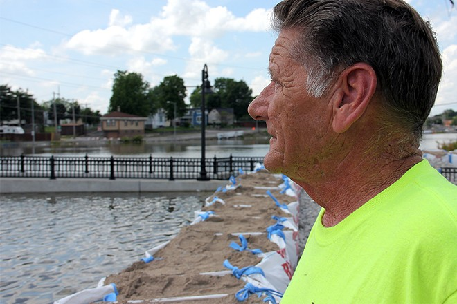 South St. Louis City resident Mike Byrne observes the flooded River Des Peres. - DANNY WICENTOWSKI