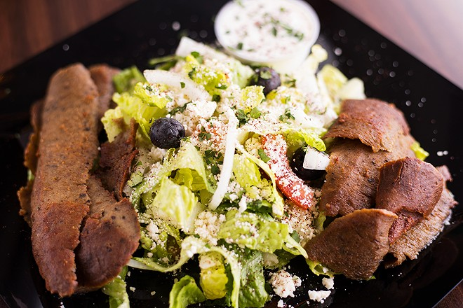 Greek salad is topped with olives, feta cheese, Greek dressing and gyro slices. - MABEL SUEN