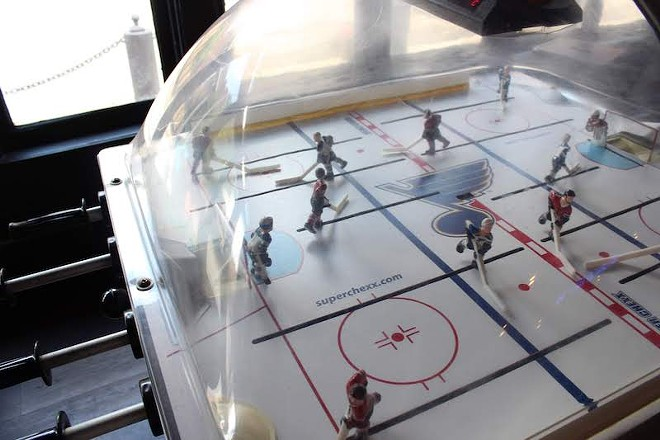 The Blues are featured in the bubble hockey game. - KATIE COUNTS