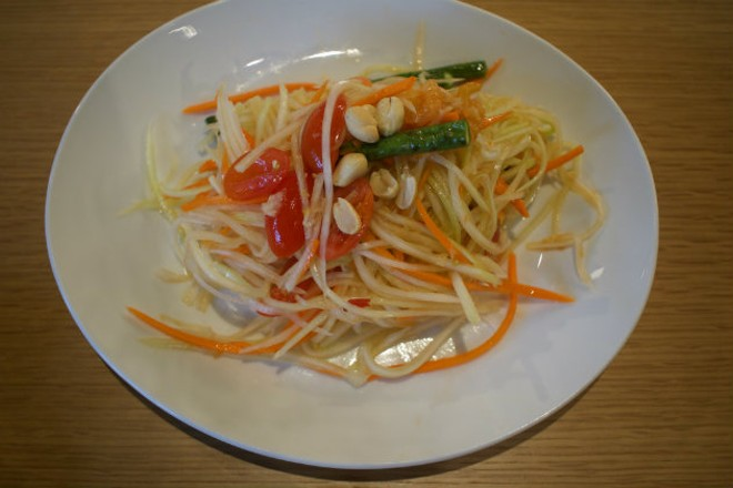 Som Tum, the popular Thai papaya salad, is sweet and spicy. - CHERYL BAEHR