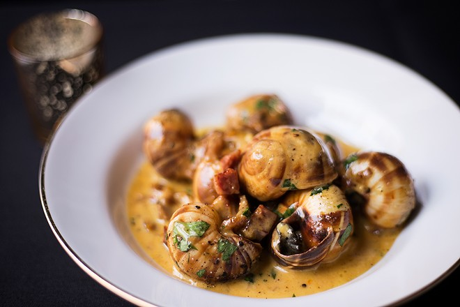 Escargot are served in the shell with Spanish chorizo, caramelized fennel, Madeira and saffron-garlic butter. - MABEL SUEN