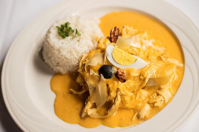 Aji de gallina: shredded chicken, spicy aji Amarillo creamy sauce, potato, rice, boiled egg and olive. - MABEL SUEN