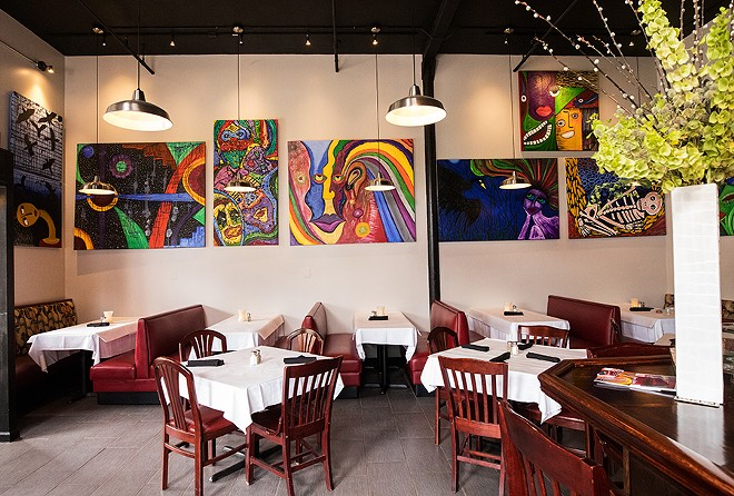 Cocina Latina's dining area features bright paintings. - MABEL SUEN