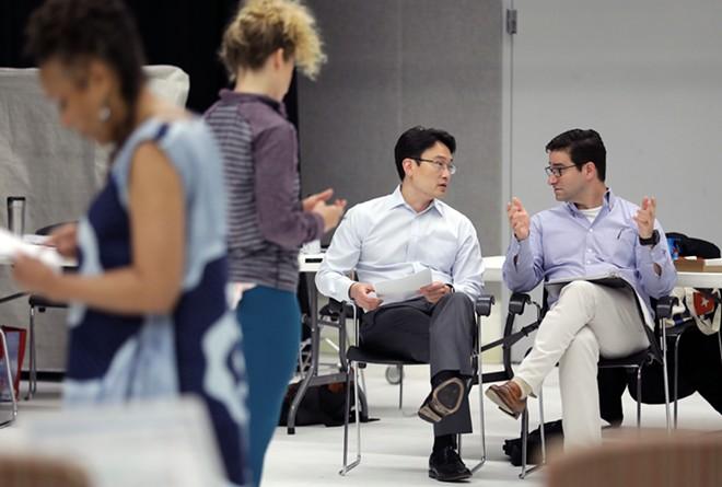 From left, doctors Albert Kim and Eric Leuthardt discussing BrainWorks. - JAMES BYARD/WASHINGTON UNIVERSITY