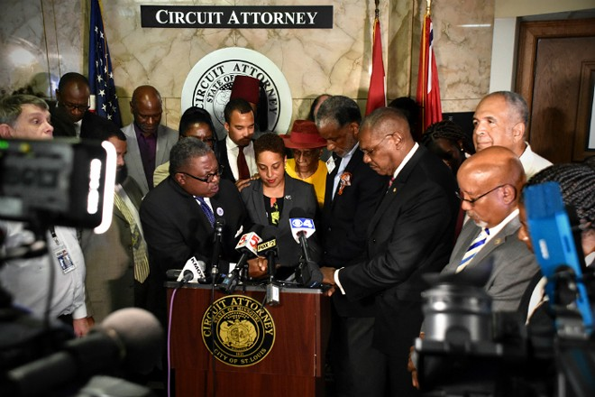 Supporters pray over St. Louis Circuit Attorney Kim Gardner. - DOYLE MURPHY