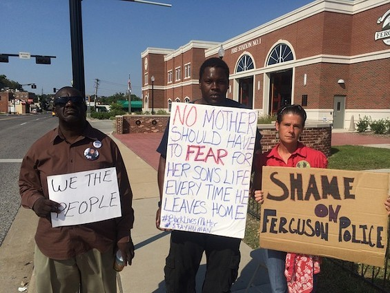 Protester Angelique Kidd, far right, is among many people who previously sued Ferguson Officer Eddie Boyd for violating their rights. - MITCH RYALS