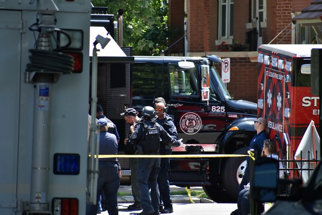 Police and medics on the scene in Tower Grove South. - DOYLE MURPHY