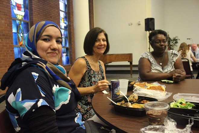 "Safaa Abdullah (pictured on the left) says whether the food is American or Arabic, ""it is very delicious."" - KATIE COUNTS"