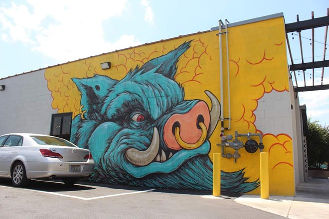 The restaurant features its own parking lot under the watchful eye of a wild boar. - KATIE COUNTS