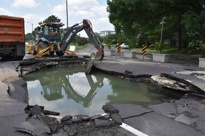 The break blew a massive hole in the roadway covering three lanes. - DANIEL HILL