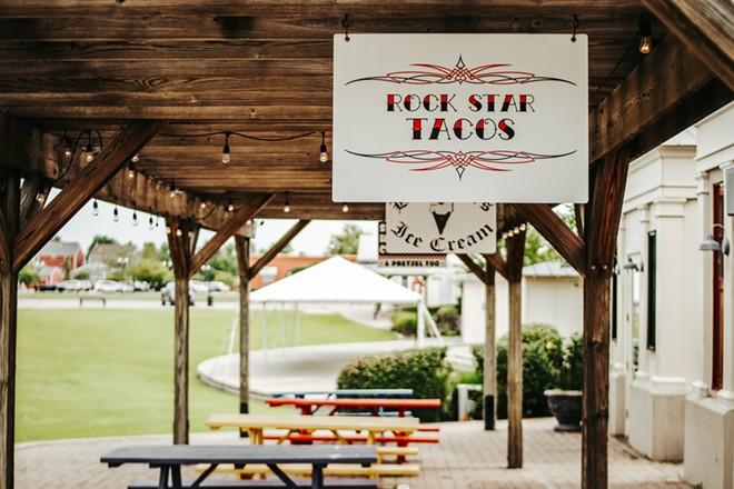Guests can relax at picnic tables behind the restaurant. - CHELSEA NEULING