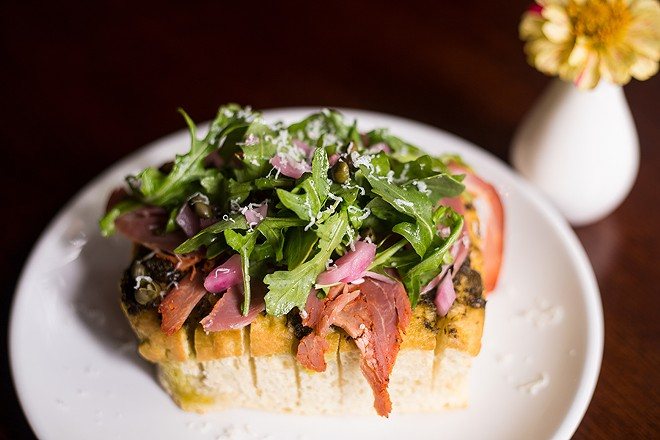 Focaccia with capicola, iberico, caper, pickled onion and arugula pesto. - MABEL SUEN