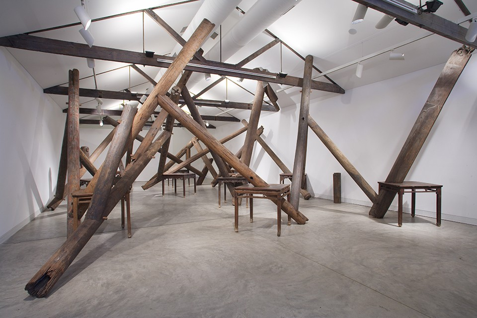 "Ai Weiwei (Chinese, b. 1957), Through, 2007–8. Wooden tables and beams and pillars from dismantled temples from the Qing dynasty (1644–1912), 216 9/16 x 334 5/8 x 543 5/16"" (550 x 850 x 1380 cm.) Courtesy of Ai Weiwei Studio. - AI WEIWEI 2012. COURTESY OF AI WEIWEI STUDIO"