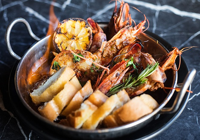 "The ""Flaming Wicked Prawns"" serve jumbo head-on prawns in a broth of dark beer, sherry wine, Bait spice and fresh herbs. - MABEL SUEN"