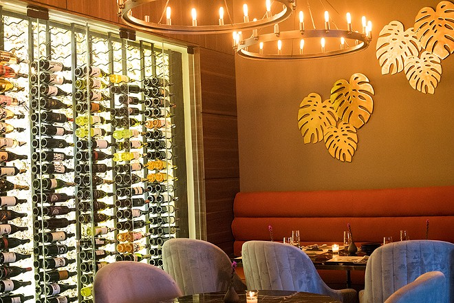 An alternate view of the dining room showcasing Bait's impressive wine selection. - MABEL SUEN