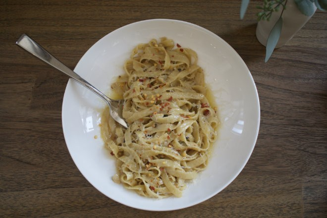 """""""Grown Up Garlic Noodles"""" are made with olive oil, fermented black garlic, chile flakes and parmesan cheese. - CHERYL BAEHR"""