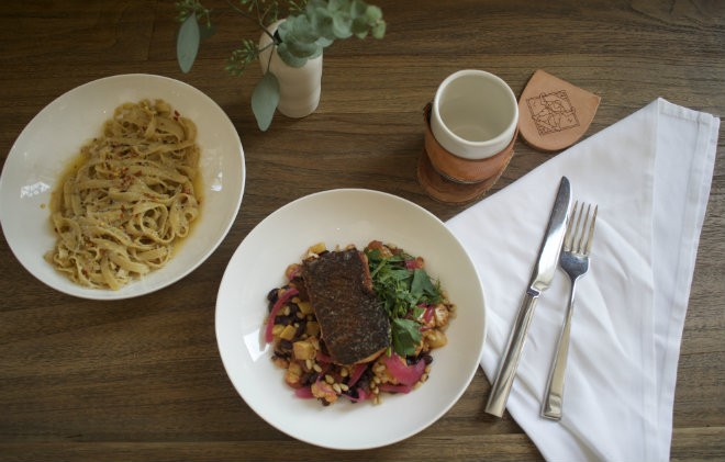 """A selection of dishes from the Last Kitchen, including """"Grown Up Garlic Noodles"""" and the salmon. - CHERYL BAEHR"""