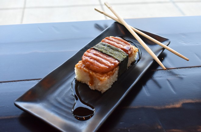 Spam musubi inspired by the popular Hawaiian street food plates a rice patty with a jalapeño-flavored piece of Spam wrapped in seaweed and served with teriyaki sauce. - LIZ MILLER