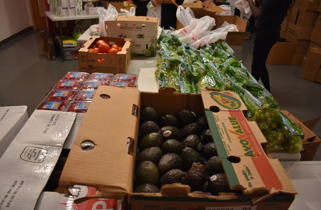 Fresh avocados, grapes and cherry tomatoes ready for students to shop. - LIZ MILLER