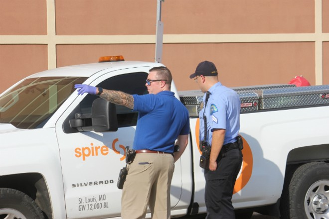 St. Louis police check out a stolen Spire truck. - DOYLE MURPHY