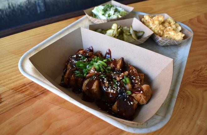 Crispy tofu with Ssam sauce, kimchi and scallions. - LIZ MILLER