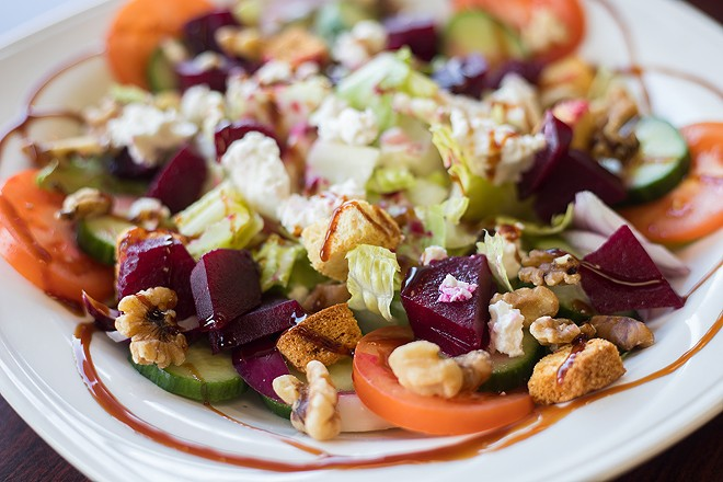 The beet salad features spring mix, beets, feta and walnuts. - MABEL SUEN