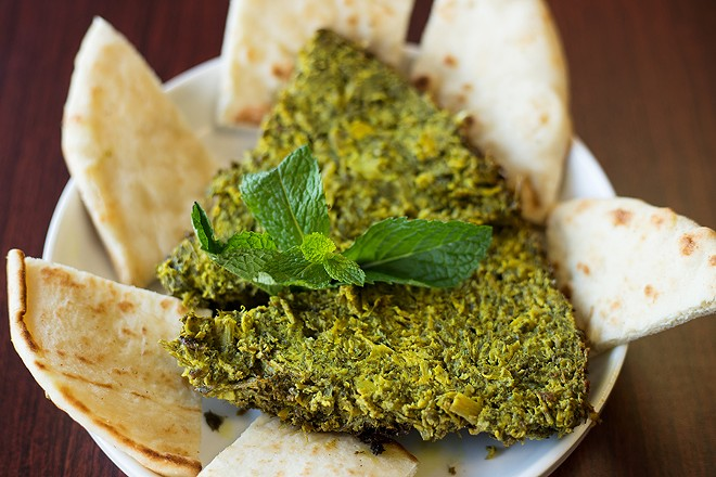The kookoo sabzi — basically, an herb frittata — is a stunningly rich and verdant concoction. - MABEL SUEN