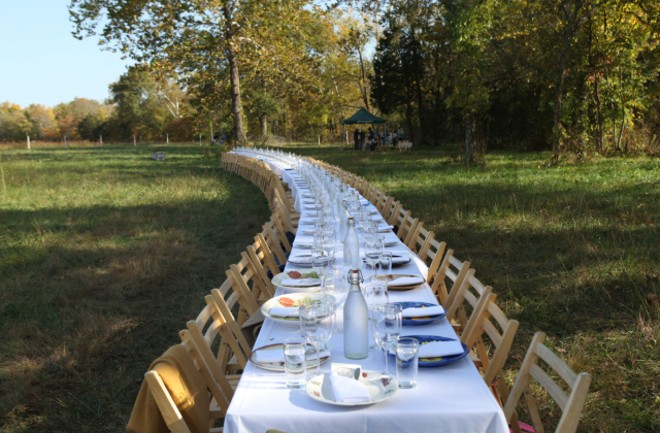 The spread at the 2015 Outstanding in the Field dinner at Such and Such Farm. - COURTESY OUTSTANDING IN THE FIELD