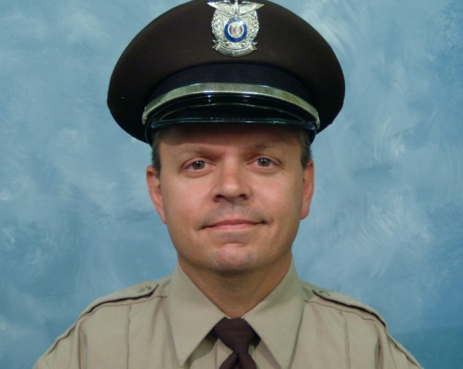 "St. Louis County police Officer James ""Mitch"" Ellis was killed in a car crash. - ST. LOUIS COUNTY POLICE"