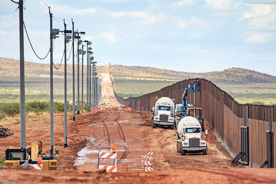 Repairmen attend to a section of the border wall near Naco, Arizona. - JOSHUA ROWAN