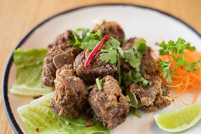 Before being breaded and fried, the pork riblets are marinated in soy, garlic and Golden Mountain sauce (a Thai sauce made from fermented soybeans), which imbues the meat with umami. - MABEL SUEN