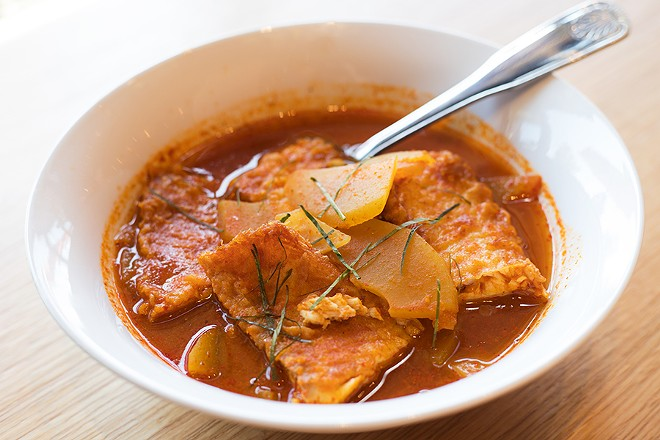 The gaeng som is a fragrant bowl of fried whitefish and papaya simmered in a turmeric and chile broth. - MABEL SUEN