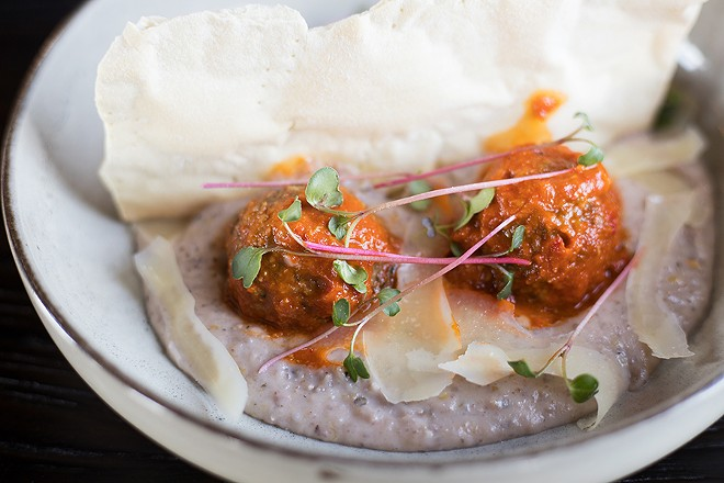 Lamb meatballs are tender and spiked with heat, but the plate's real highlights are the shockingly creamy grits and lavash crackers made with lamb fat. - MABEL SUEN