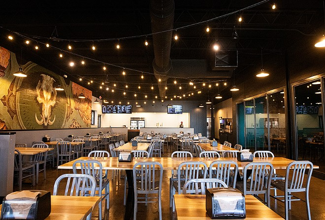 Inside, BEAST Butcher & Block includes a traditional fast-casual smokehouse with a large open dining room and order counter. - MABEL SUEN