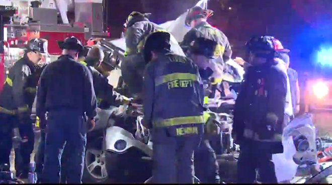 Firefighters at the scene of Tuesday's deadly crash. - SCREENSHOT FROM KSDK'S REPORT