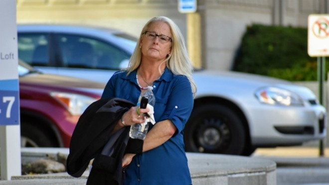 Ex-St. Louis police officer Lori Wozniak leaves court on Tuesday. - DOYLE MURPHY