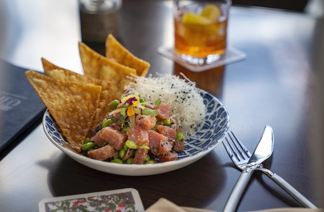 Beet poke with edamame, sesame, candied ginger, a soy-mirin reduction and wonton chips. - COURTESY OF LODGING HOSPITALITY MANAGEMENT