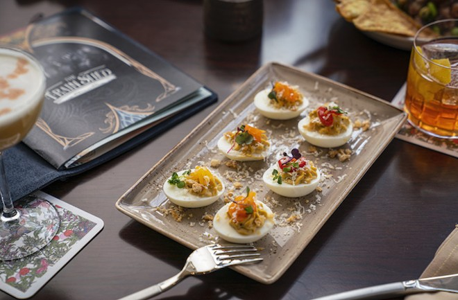 Green chile deviled eggs with pork rinds, pickled pepper and cotija cheese. - COURTESY OF LODGING HOSPITALITY MANAGEMENT