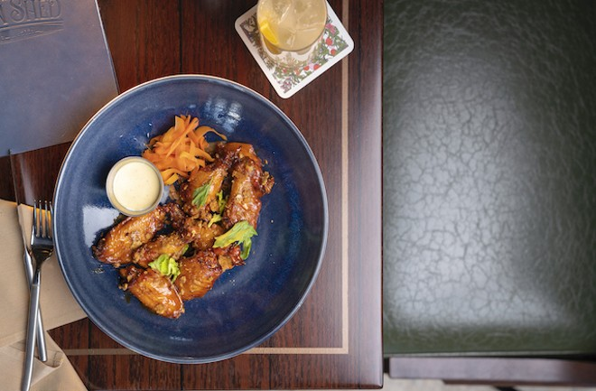 Smoked honey-Buffalo wings with pickled carrot, celery hearts, buttermilk dressing and blue cheese crisps. - COURTESY OF LODGING HOSPITALITY MANAGEMENT