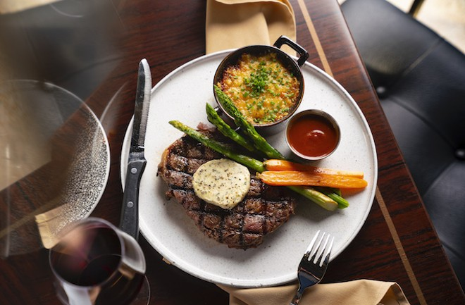 Twelve-ounce ribeye with au gratin potatoes. asparagus, carrots and housemade steak sauce. - COURTESY OF LODGING HOSPITALITY MANAGEMENT
