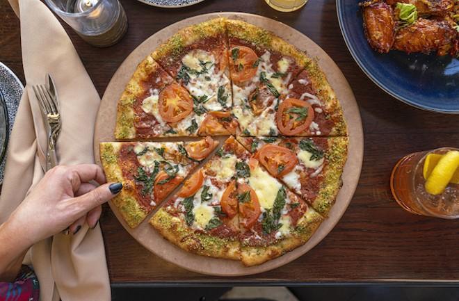 Margherita pizza with fresh basil, roasted garlic, fresh mozzarella and basil Parmesan. - COURTESY OF LODGING HOSPITALITY MANAGEMENT