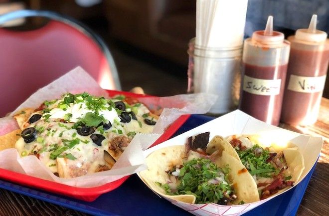Pulled pork nachos and the brisket taco with burnt-end-style brisket points,  smoked tomato jam, onion, queso, cilantro and J's Sauce. - LIZ MILLER
