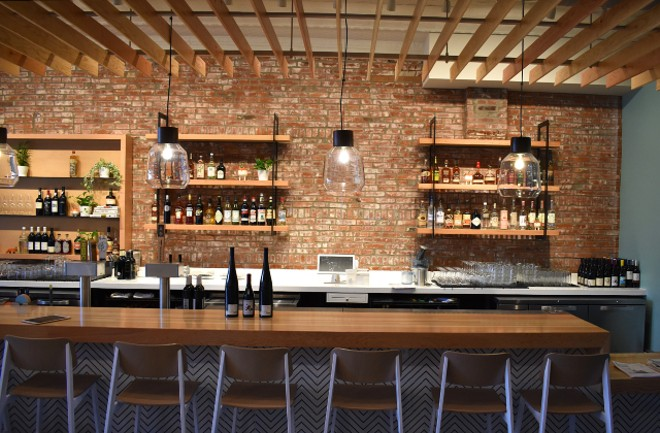 Behind the bar, beverage director Kelly Nyikes has curated a selection of natural wines for Little Fox. - LIZ MILLER