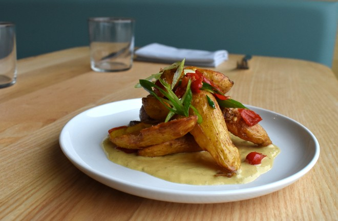 Crispy fingerling potatoes with little sweetie peppers, scallions and tomato. - LIZ MILLER