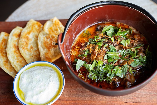 Short rib curry with red curry, labneh and roti flatbread. - MABEL SUEN