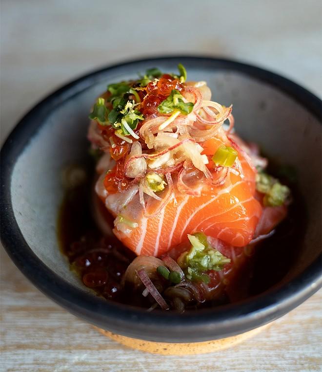 Salmon sashimi in ponzu sauce with marinated salmon roe. - MABEL SUEN
