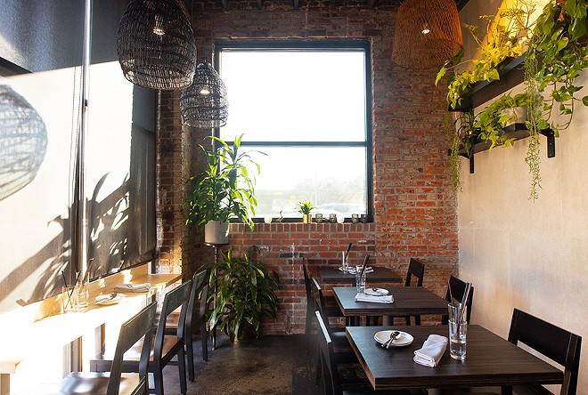The front dining area is cozy and faces the chef's table. - MABEL SUEN