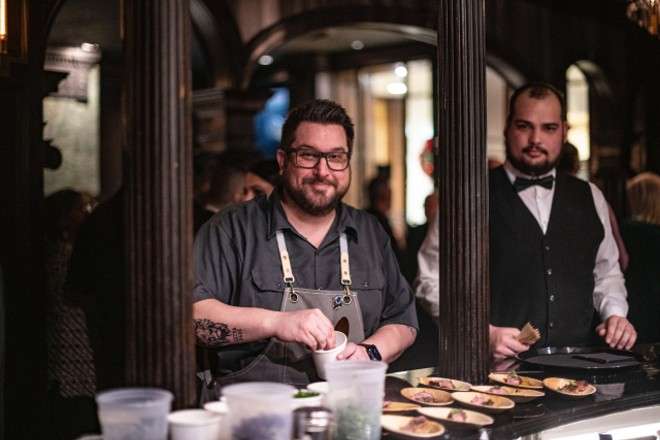 Bob Brazell plates dishes from the new chef's counter. - ED ALLER