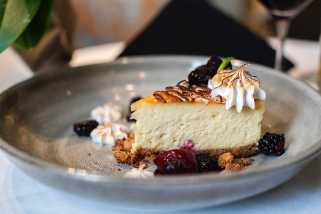 Tahitian vanilla cheesecake with white chocolate, Graham cracker and a seasonal compote. - ED ALLER